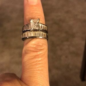 Lab created white topaz and silver wedding rings.
